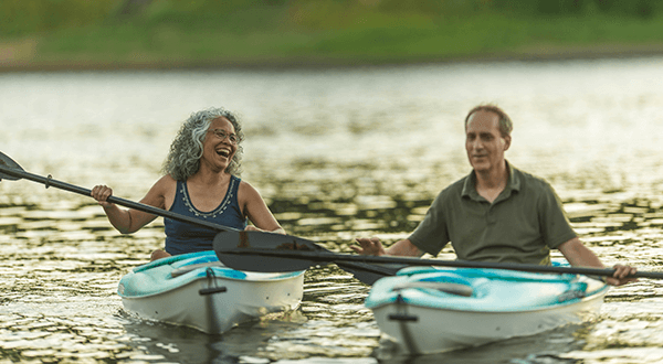A man and woman kayaking stock photo